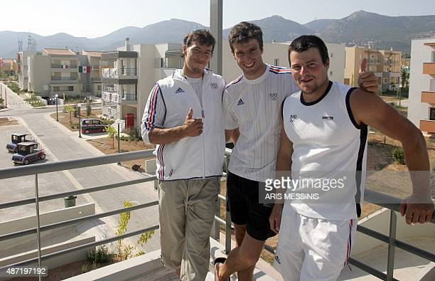 French Olympic gold medalist at C1 Slalom Canoe / Kayak Tony Estanguet Benoit Peschier and Nicolas Peschier pose for a photo at their apartment in...