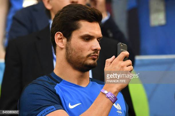French Olympic swimming champion Florent Manaudou attends the Euro 2016 semifinal football match between Germany and France at the Stade Velodrome in...