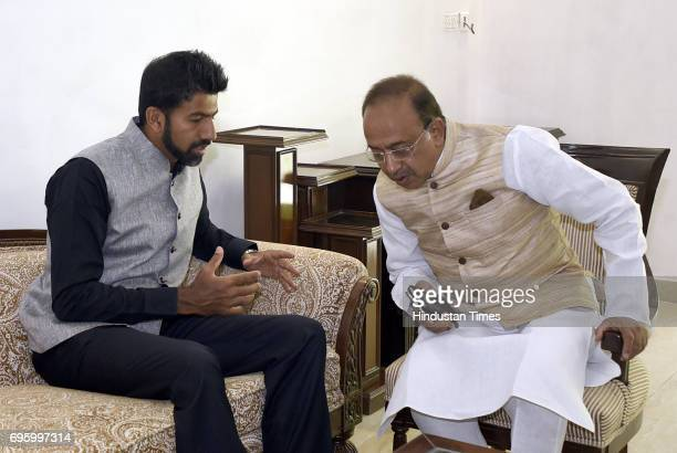 French Open Mixed Doubles champion Rohan Bopanna during a meeting with Sports Minister Vijay Goel at his residence on June 14 2017 in New Delhi India
