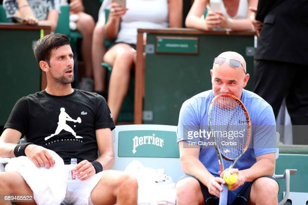 French Open Tennis Tournament Children's Day Novak Djokovic of Serbia with his coach Andre Agassi practicing on Court PhilippeChatrier in preparation...