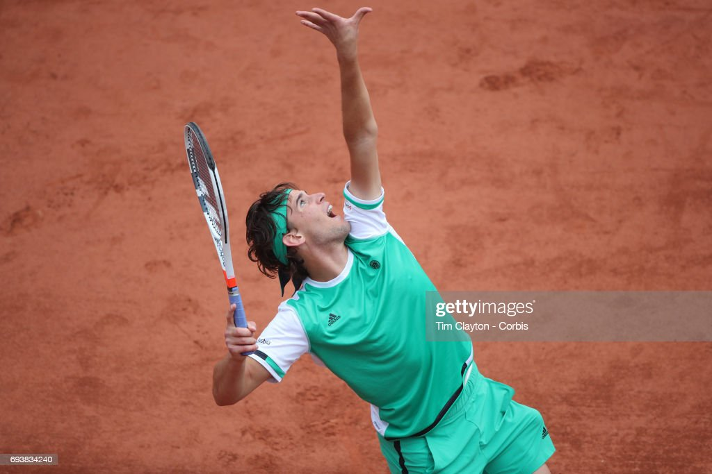 French Open Tennis Tournament - Day Eleven. Dominic Thiem of Austria in action against Novak Djokovic of Serbia in the Men's Singles Quarter Final match on Suzanne-Lenglen Court at the 2017 French Open Tennis Tournament at Roland Garros on June 7th, 2017 in Paris, France.