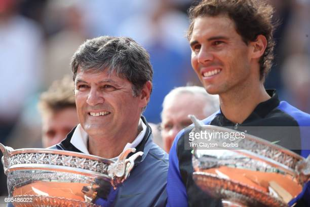 French Open Tennis Tournament Day Fifteen Uncle Toni Nadal presents the trophy in honor of Rafael Nadal of Spain's tenth Round Garros Men's singles...