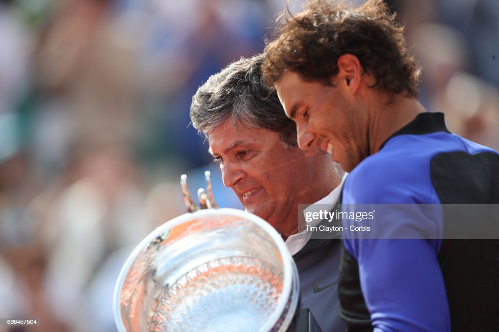 French Open Tennis Tournament - Day Fifteen. Uncle Toni Nadal presents the trophy in honor of Rafael Nadal of Spain's tenth Round Garros Men's singles title win after he defeated Stan Wawrinka of Switzerland in the Men's Singles Final match on Philippe-Chatrier Court at the 2017 French Open Tennis Tournament at Roland Garros on June 11th, 2017 in Paris, France.