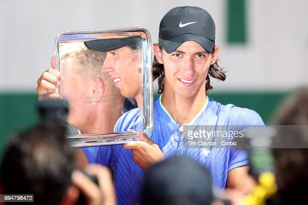 French Open Tennis Tournament Day Fourteen Alexei Popyrin of Australian with the trophy after defeating Nicola Kuhn of Spain to win the Boy's Singles...