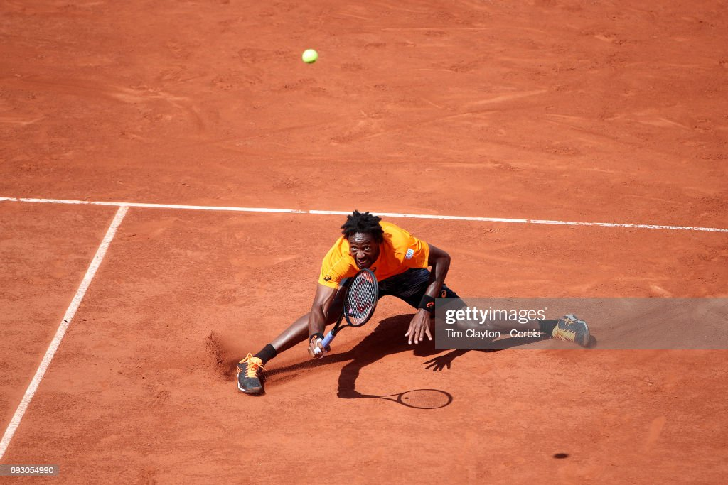 French Open Tennis Tournament - Day Nine. Gael Monfils of France in action against Stan Wawrinka of Switzerland in the Men's Singles fourth round match on Philippe-Chatrier Court at the 2017 French Open Tennis Tournament at Roland Garros on June 5th, 2017 in Paris, France.