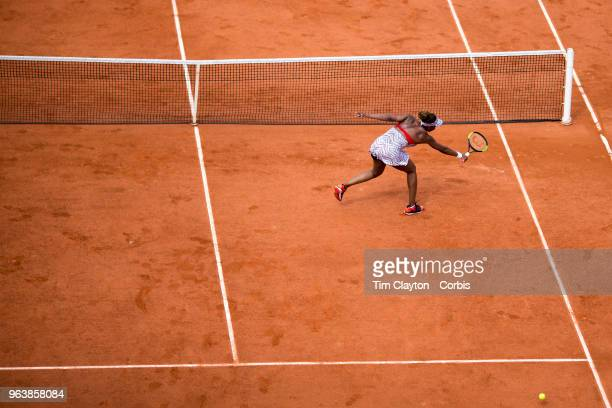 French Open Tennis Tournament Day One Venus Williams of the United States is passed by a shot during her loss to Wang Qiang of China on Court...