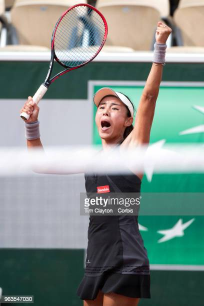 French Open Tennis Tournament Day One Wang Qiang of China celebrates her victory over Venus Williams of the United States on Court SuzanneLenglen in...