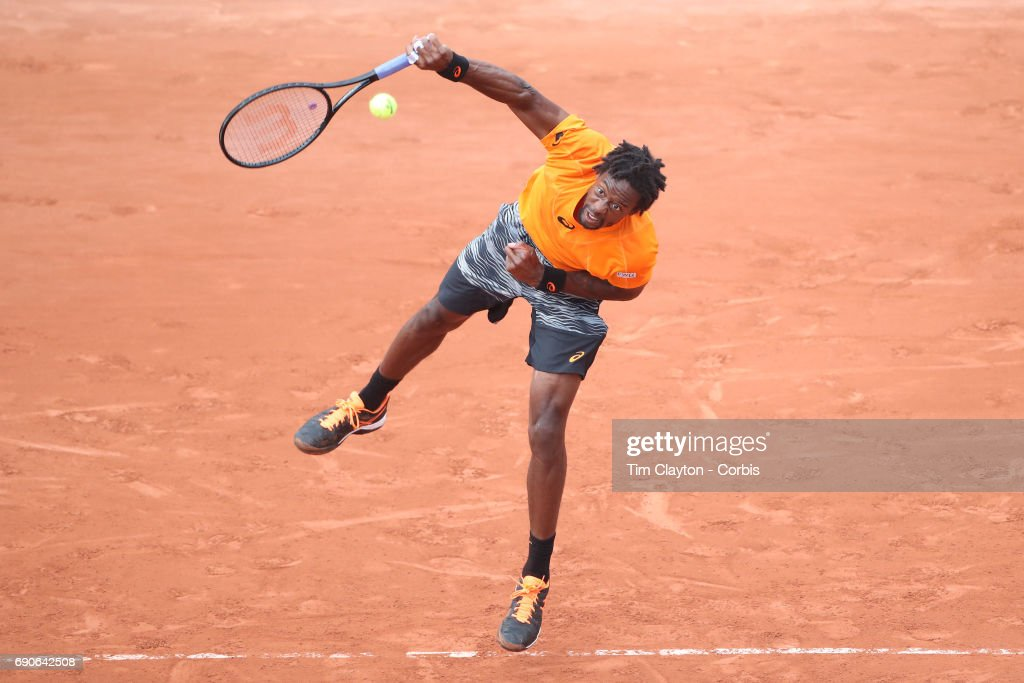 French Open Tennis Tournament - Day Three. Gael Monfils of France in action against Dustin Brown of Germany on Suzanne-Lenglen Court during the Men's Singles round one match at the 2017 French Open Tennis Tournament at Roland Garros on May 30th, 2017 in Paris, France.