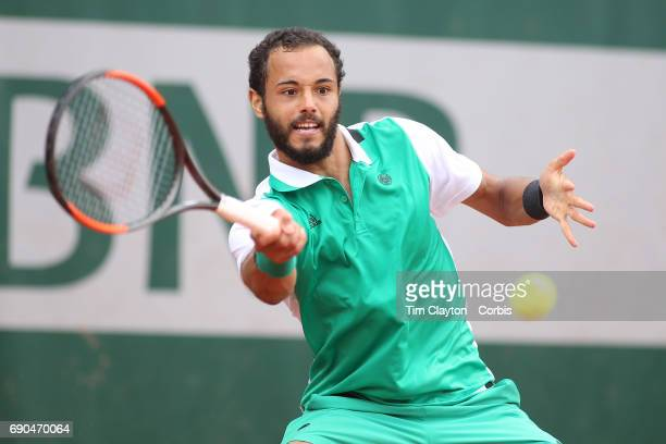 French Open Tennis Tournament - Day Three. Laurent Lokoli of France in action during his loss to Martin Klizan of Slovakia during a tension filled...