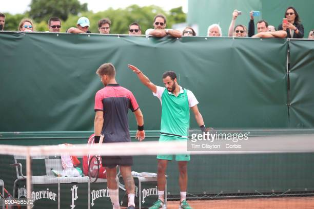 French Open Tennis Tournament - Day Three. Laurent Lokoli of France refuses to shake hands with winner Martin Klizan of Slovakia and waves him away...