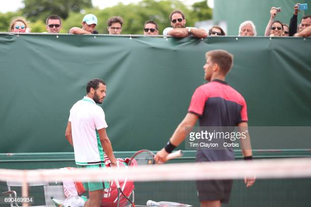 French Open Tennis Tournament - Day Three. Laurent Lokoli of France refuses to shake hands with winner Martin Klizan of Slovakia during a tension...