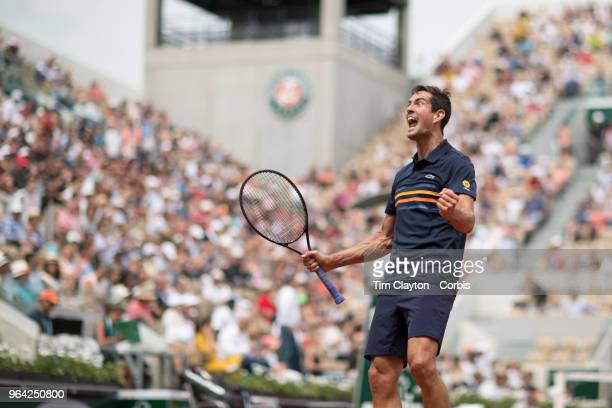 French Open Tennis Tournament - Day Two. Guillermo Garcia-Lopez of Spain celebrates his five set victory over Stan Wawrinka of Switzerland on Court...
