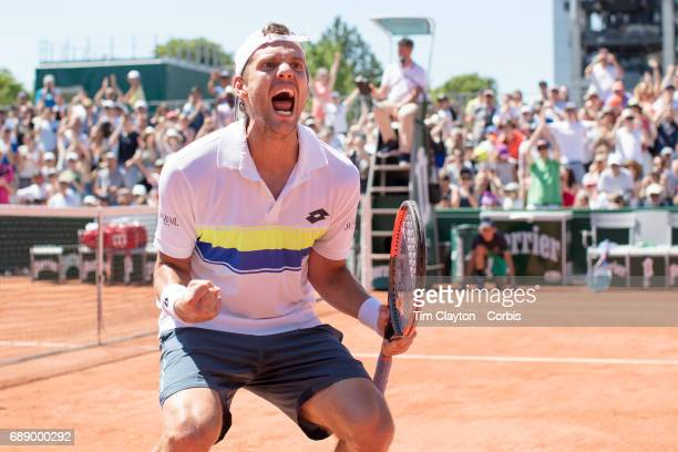 French Open Tennis Tournament - Paul-Henri Mathieu of France celebrates his victory against Denis Kudla of the United States in the Qualifying Men's...