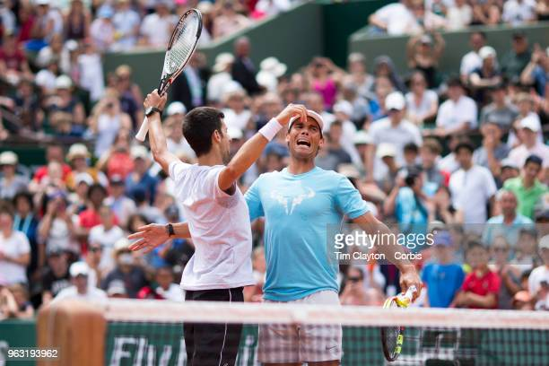 French Open Tennis Tournament - Rafael Nadal of Spain and Novak Djokovic of Serbia celebrate after winning a tie break doubles exhibition match...