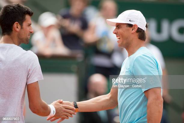 French Open Tennis Tournament Rafael Nadal of Spain with Novak Djokovic of Serbia in a tie break doubles exhibition match against Simone Halep of...