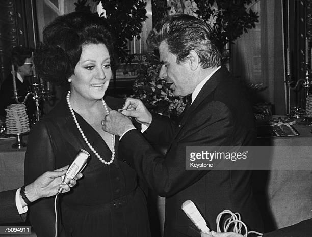 French opera singer Regine Crespin receives the Croix de Chevalier de la Legion d'Honneur from French Minister of Cultural Affairs Jacques Duhamel at...