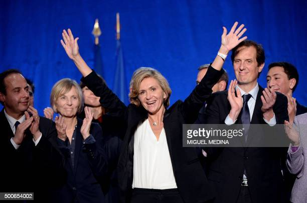 French opposition rightwing Les Republicains party top candidate for the regional elections in the IledeFrance region Valerie Pecresse waves flanked...