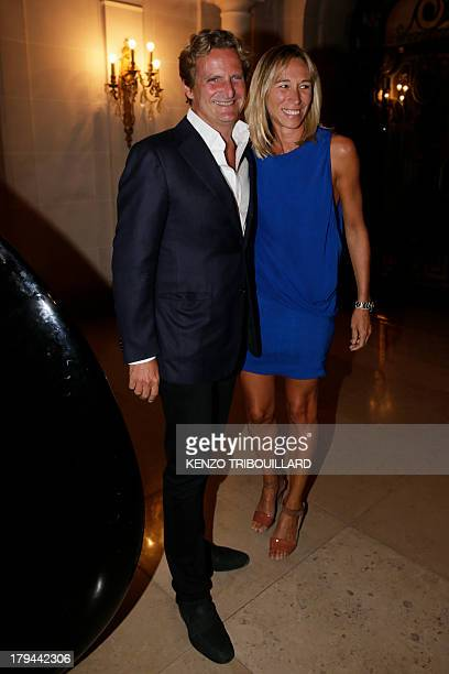 French opposition rightwing party UMP member Charles Beigbeder and his wife Carine poses for a photograph during the launch of the new version of the...