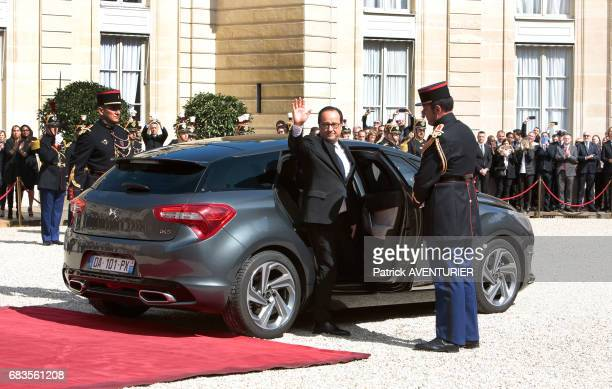 French outgoing President François Hollande leaves the Elysée presidential Palace at the end of the handover ceremony with newly elected French...