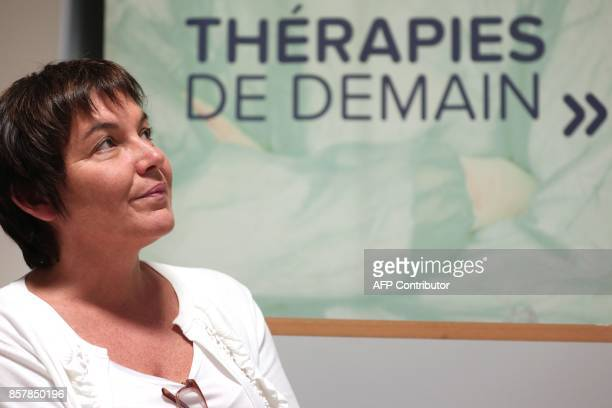 French Overseas Minister Annick Girardin is pictured as she visits the Torskal biotechnology company in SaintDenis de la Reunion as part of her visit...