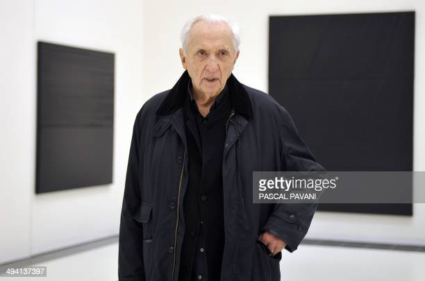 French painter engraver and sculptor Pierre Soulages poses in front of his painting at the museum of the « Outrenoir » master on May 28 2014 in the...