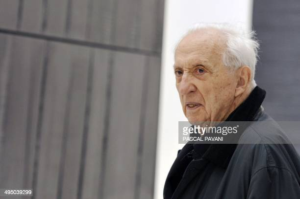 French painter engraver and sculptor Pierre Soulages poses in front of one of his paintings at the museum of the « Outrenoir » master on May 28 2014...