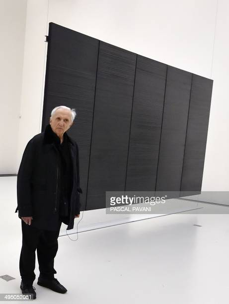 French painter engraver and sculptor Pierre Soulages poses in front of one of his paintings as part of the « Pierre Soulages' Outrenoir paintings...