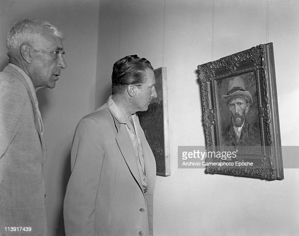 French painter Georges Braque with the art dealer Aime Maeght watching Van Gogh self-portrait at the Art Biennale in Venice, 1948.