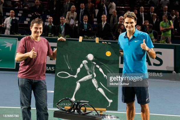 French painter Jerome Mesnager and Roger Federer during the 'BNP Paribas' Tennis Masters Final in Bercy at Palais Omnisports de Bercy on November 13,...