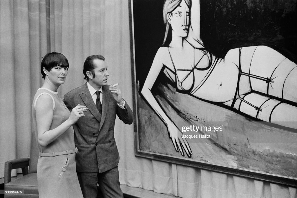 French painter of Expressionism Bernard Buffet with wife writer and actress Annabel Schwob during an exhibition of his paintings.
