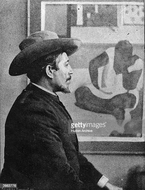 French painter Paul Gauguin seated in front of one of his paintings. Original Publication: People Disc - HD0269