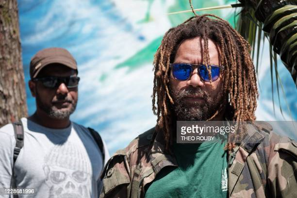 French painters Adilio Poacoudou and Gilles Kanvapose pose as they take part in a symbolic day marking the taking of possession of New Caledonia by...