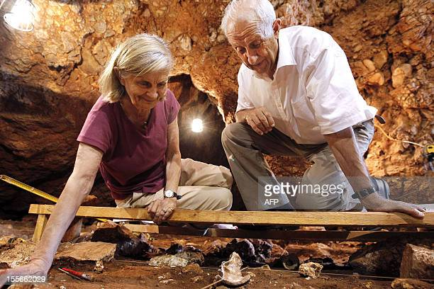French paleontologist MarieAntoinette De Lumley and her husband Henry De Lumley look at a 170000 year old forehead bone discovered in the coastal...