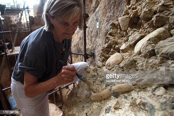 French paleontologist MarieAntoinette De Lumley works at the archaeological prehistoric site of Caune de l'Arago in Tautavel on July 16 2013 Forty...