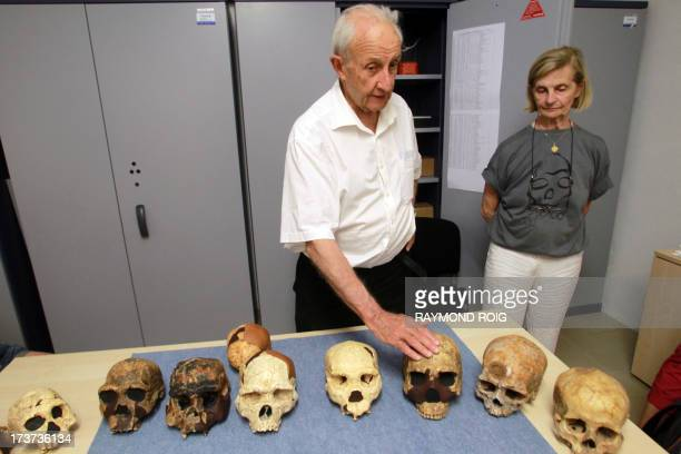 French paleontologists Henri De Lumley and his wife MarieAntoinette show skulls uncovered in 1971 at the prehistoric site of Caune de l'Arago in...