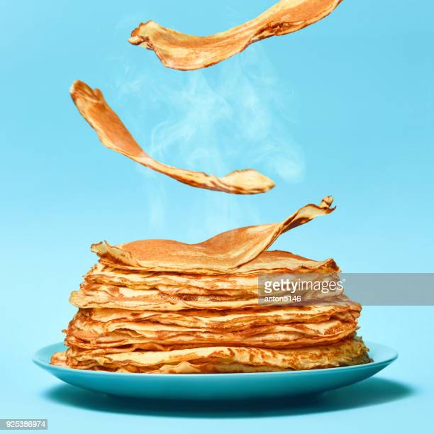 french pancakes is flying on the blue background - pancake stock pictures, royalty-free photos & images