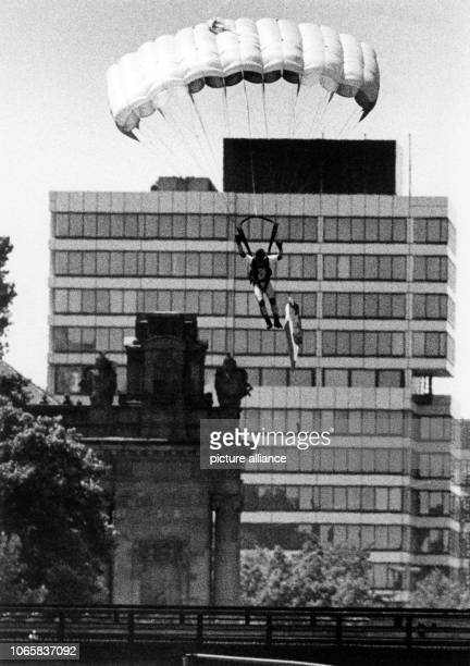 A French parachutist during a parade of the allied armed forces in Berlin on 14 January 1986 He missed his target and landed not at the 'Siegessäule'...
