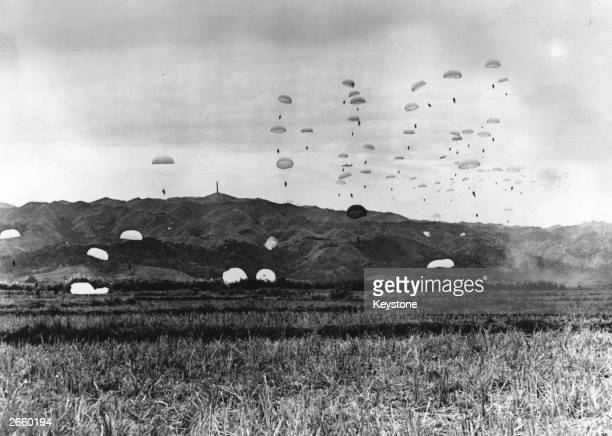 French parachutists being dropped over Dien Bien Phu, in Vietnam, the enemy stronghold which was captured by the paratroopers.