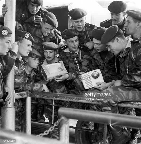 French parachutists in Algiers listen to General DE GAULLE's speech on the radio The city was in a state of insurrection since the Week of Barricades...