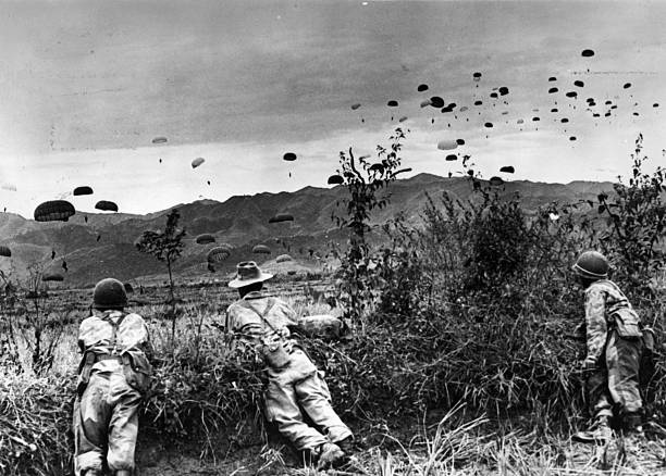 French parachutists watching comrades being dropped...