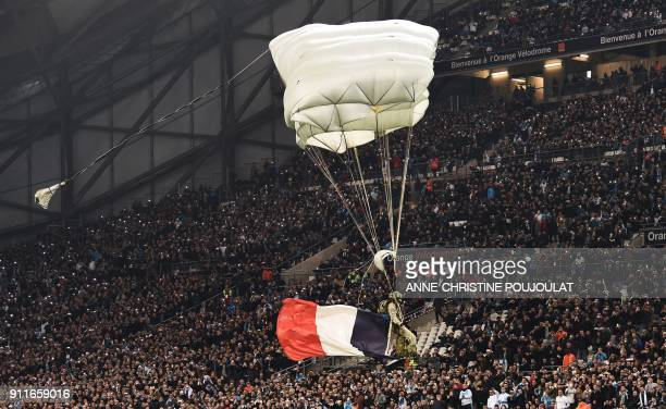 A French paratrooper arrives at the Velodrome stadium in Marseille southern France before the French L1 football match between Marseille and Monaco...