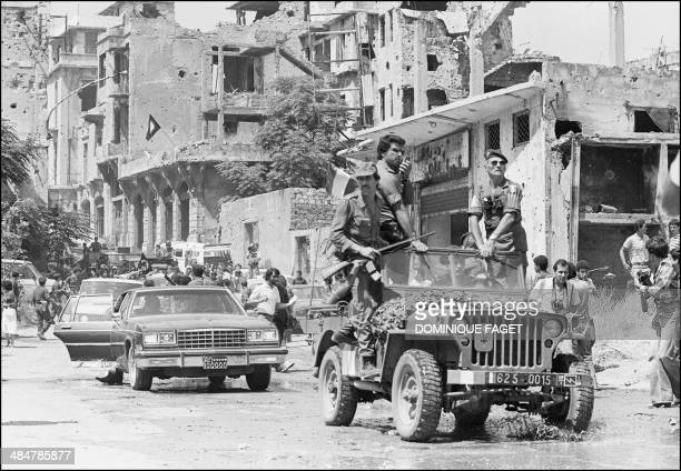 French paratrooper officer atop a French military jeep and Palestinian fighters precedes the motorcade of Palestine Liberation Organisation chairman...
