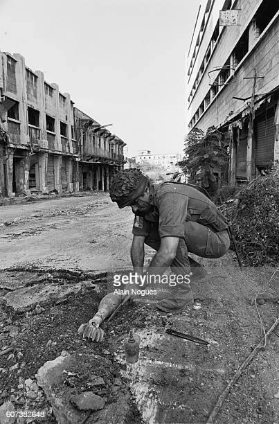 A French paratrooper on a mineclearance mission has found a mortar shell in a Beirut street The ruins testify to the intense fighting going on in the...