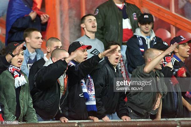 French Paris Saint Germain supporters raise their arms in a nazi salute during the PSGMaccabi Haifa match at the Parc des Princes Stadium in Paris 17...