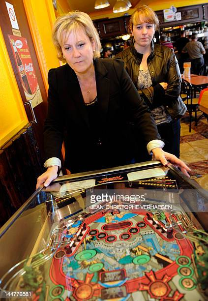 French parliamentary election UMP candidate Nadine Morano plays to pinball machine after distributing electoral leaflets on a market on May 19 2012...