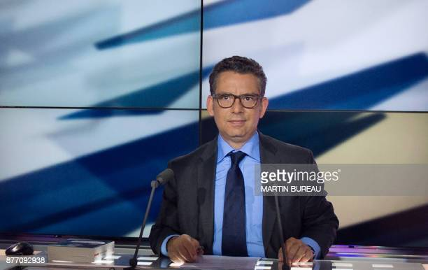 French Parliamentary TV presenter Frederic Haziza looks on during a broadcast on May 14 2013 in Paris French journalist Astrid Villaines on November...