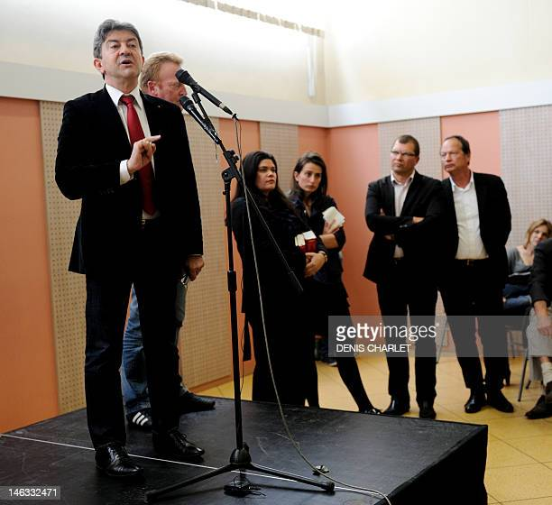 French Parti de Gauche leader JeanLuc Melenchon delivers a speech next to Philippe Kemel the Socialist Party candidate for the June 2012 French...