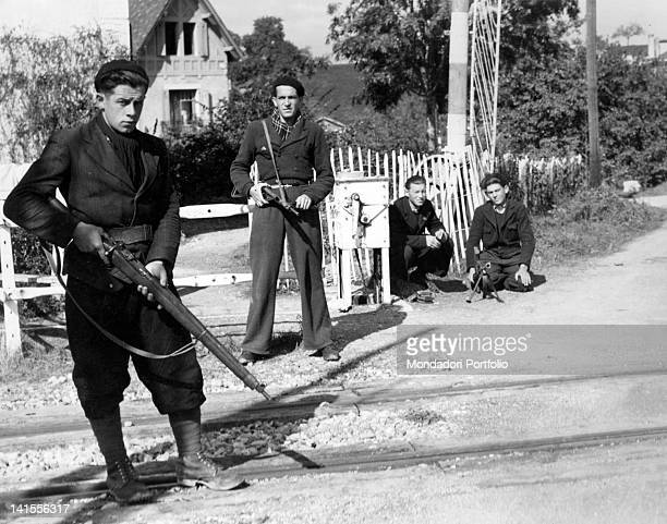 French partisans controlling a checkpoint on the road to Switzerland France October 1944