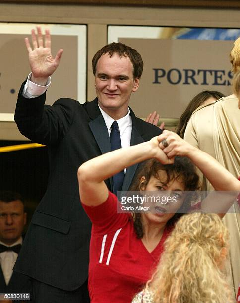 French parttime film and theatre industry workers protest government cuts to their unempoyement benefits as US film directors Quentin Tarantino walks...
