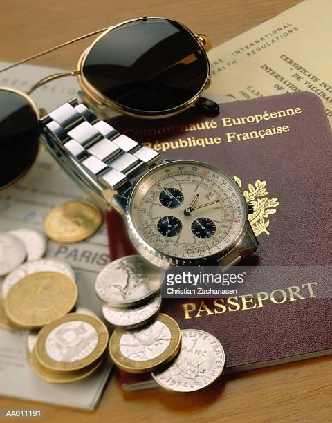French Passport, Money, Wristwatch and Sunglasses